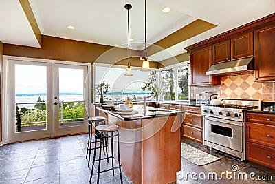 Luxury kitchen interior with water view.