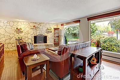 Luxury living room with stone wall trim and fireplace furnished with