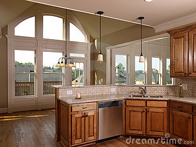 Luxury Model Home Maple Kitchen with window