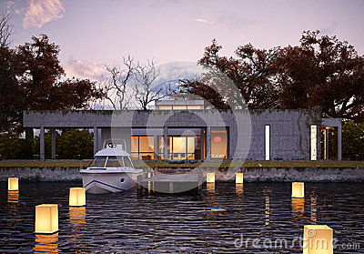Luxury modern house on water at sunset.