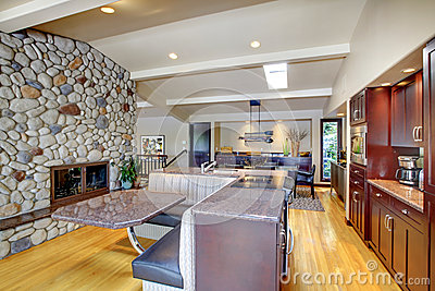 Luxury mohogany Kitchen with modern furniture and stone fireplace.