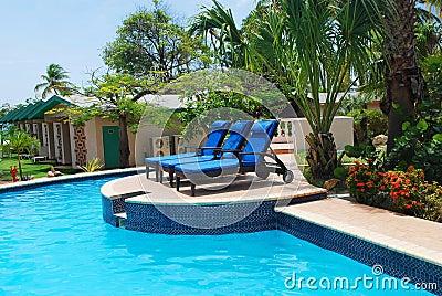 Luxury Resort Pool and hotel garden in Aruba.