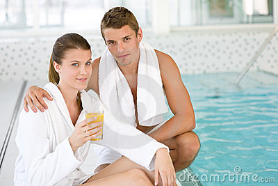Luxury spa - young sportive couple relax at pool