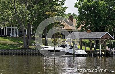 Luxury speed boat tied to dock