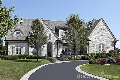 Luxury stone home with circular driveway