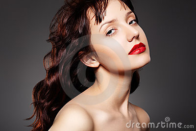 Luxury woman with evening make-up and long hair