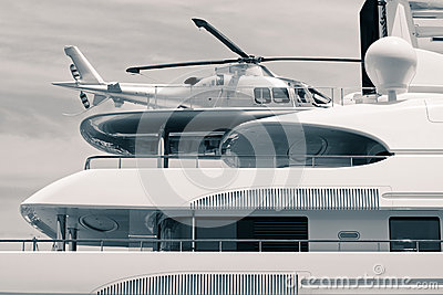 Luxury yacht with helicopter on the roof