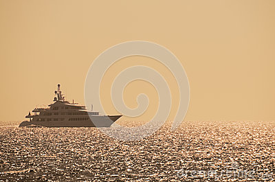 Luxury yacht on the ocean at sunset