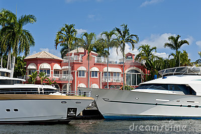 Luxury yachts and mansion