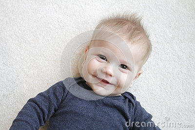 Lycklig babyansikte