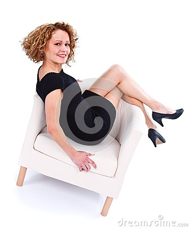 Lying back in armchair