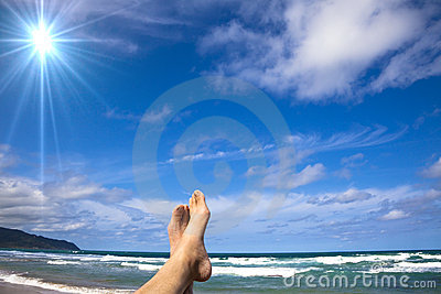 Lying on the beach watch my feet