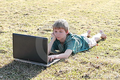 Lying boy interested in a computer
