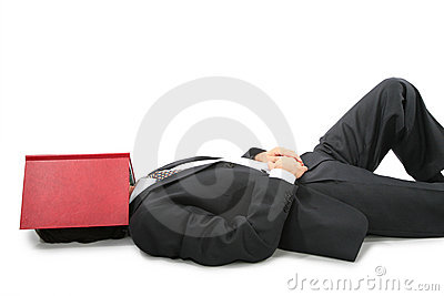 Lying businessman with book on face
