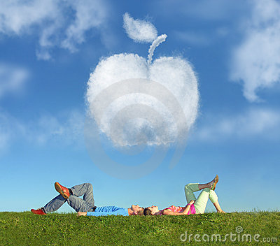 Lying couple on grass and dream apple collage