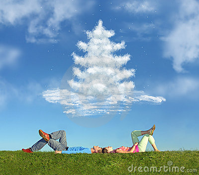Lying couple on grass and dream christmas tree