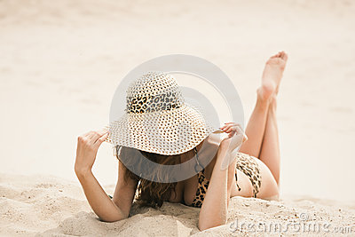 Lying on sand