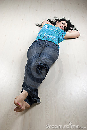Lying woman on white laminate flooring