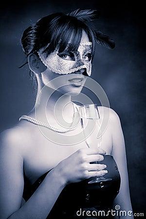 Máscara y champán
