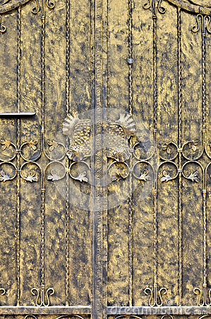 Målningdörren i guld- färgar