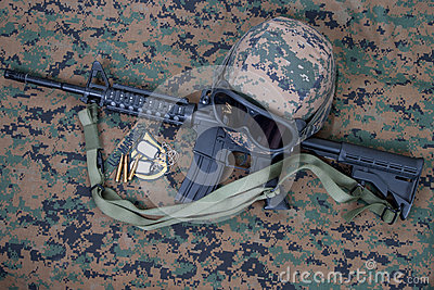 M4 carbine, kevlar helm with goggles and blank dog tags on us marines camouflage uniform Editorial Photography