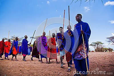 Maasai men in their ritual dance in their village in Tanzania, Africa Editorial Stock Image