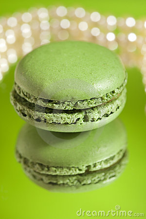 Macaron Matcha Green  with its own reflection