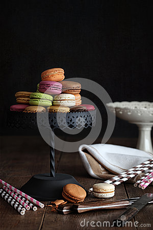 Macaroons on cake stand with dark background