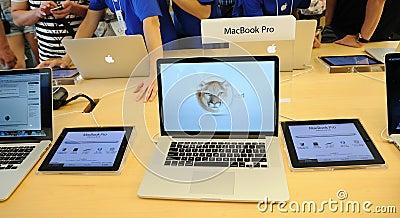 Macbook pro display in Apple store Editorial Image