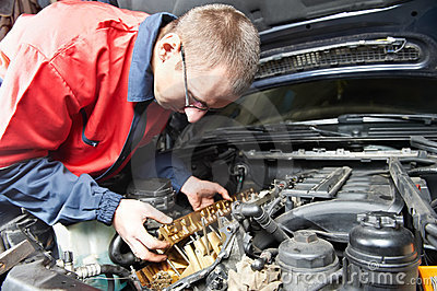 Machanic repairman at automobile car engine repair