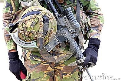 Machine gun and soldier helmet