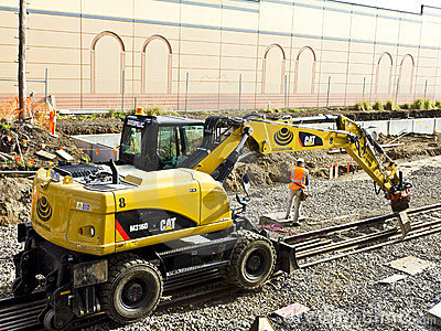 Machine laying rail track Editorial Image