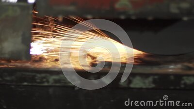 The machine processes metal forming sparks. stock video