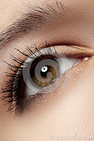 Macro eye with fashion light make-up, long eyelashes