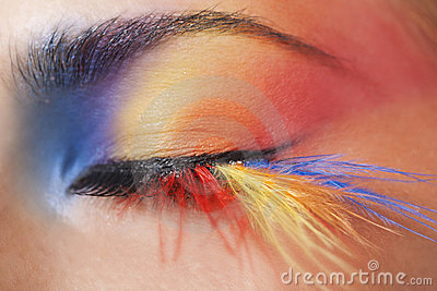 Macro eye of a woman with bright eyeshadow