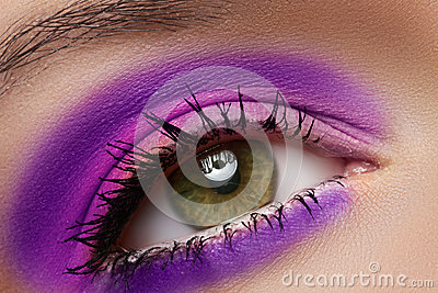 Macro of female eye with violet fashion make-up