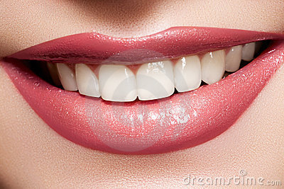 Macro happy female smile with health white teeth