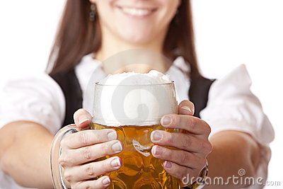 Macro of Oktoberfest beer stein held by woman