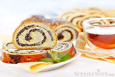 Macro of poppy seed roll slices and tea