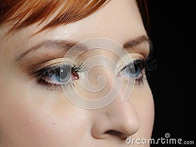 Macro shot of blue eyes with long lashes