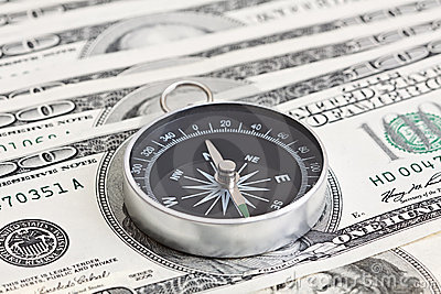 Macro shot of compass with 100 dollar