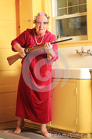 Free Mad Granny With Rifle Royalty Free Stock Image - 56031106