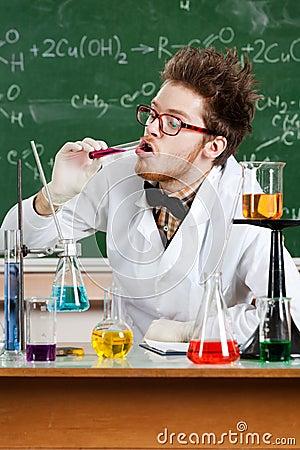 Mad professor tastes the liquid in the vial