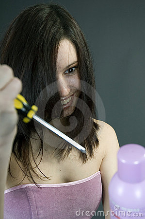 Mad woman stabbing the hair spray