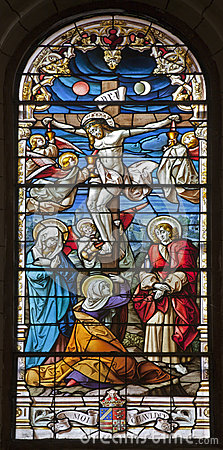 Madrid - Jesus on the cross. Windowpane from gothic church San Jeronimo el Real