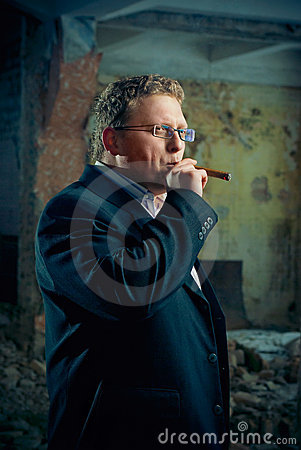 Mafia (gangster) boss smoking cigar