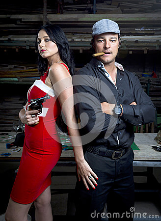 Mafia man and woman in warehouse