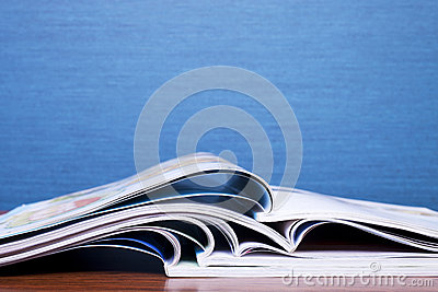 Magazines on Blue Background