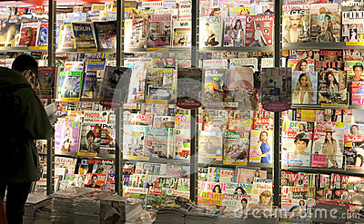 Magazines in press stand Editorial Photo