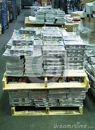 Magazines on skids in warehouse Editorial Photography